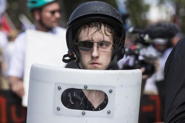 slide-21-of-40-charlottesville-usa-august-12-a-white-supremacists-with-one-lens-knocked-out-of-his-s_521825_